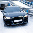 Black prestigious car on snow — Stock Photo
