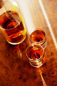 Cognac and two wine-glasses — Stock Photo