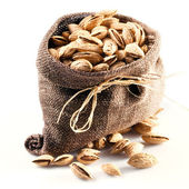 Almond. nuts in bag on white background — Stock Photo