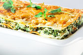 Italian cuisine. Spinach lasagna with basil. Macro — Stock Photo