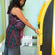 Royalty-Free Stock Photo: Woman at ATM