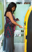 Woman at ATM — Stock Photo