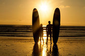 Beach surfer silhouette — Stock Photo