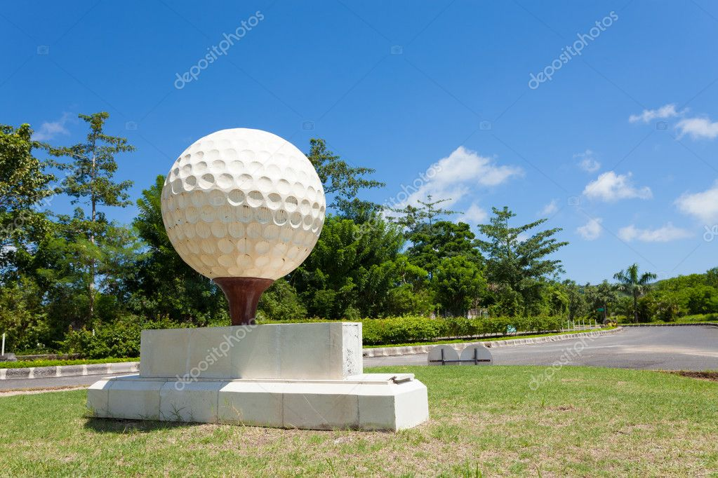 Large golf ball at the entrance of golf course in Bali, Indonesia.  Stock Photo #10631479