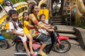Family on motorcycle — Stock Photo