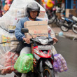 Overloaded motorcycle — Stock Photo