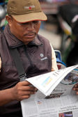 Newspaper reader — Stock Photo