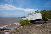 Boat washed up — Stock Photo