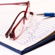 Glasses and pen — Stock Photo