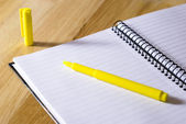 Spiral notebook with highlighter — Stock Photo