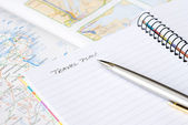 Spiral notebook with pen and map — Stock Photo