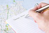 Hand writing travel plan — Stock Photo