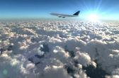 Plane and sun flare — Stock Photo
