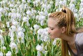 Smelling Iris Flowers — Stock Photo