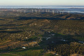 Aerial view of landscape with windmills on the horizon — Stock Photo
