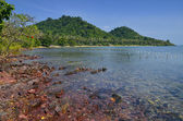 Red rocks and translucid sea at Cambodian island — Stock Photo
