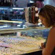 Girl choosing ring in jewelery — Stock Photo #10517998