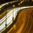 Highway traffic at night - Stock Photo