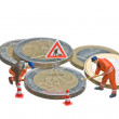 Miniature figures working on a heap of Euro coins. - Stock Photo