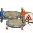 Miniature figures working on a heap of Euro coins. — Stock Photo