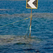 Traffic sign on the ocean. — Stock Photo