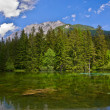 Small lake in the mountains - Stock Photo