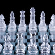 Macro shot of glass chess set against a black background — Stock Photo #9075144