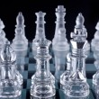 Macro shot of glass chess set against a black background — Stok fotoğraf