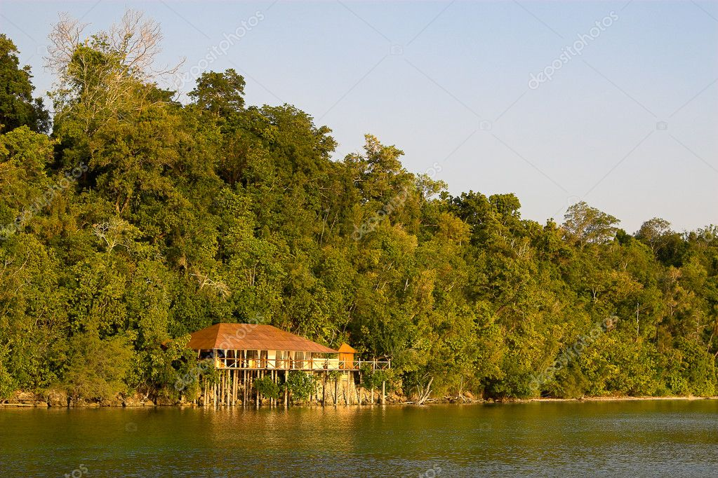 Beach bungalow on the Togian Islands (Indonesia).  Stock Photo #9073551