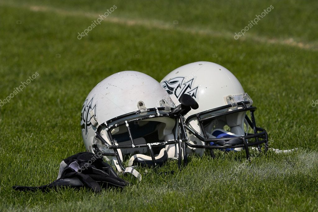 Two football helmets placed side by side on the playing field. — Stock Photo #9073930
