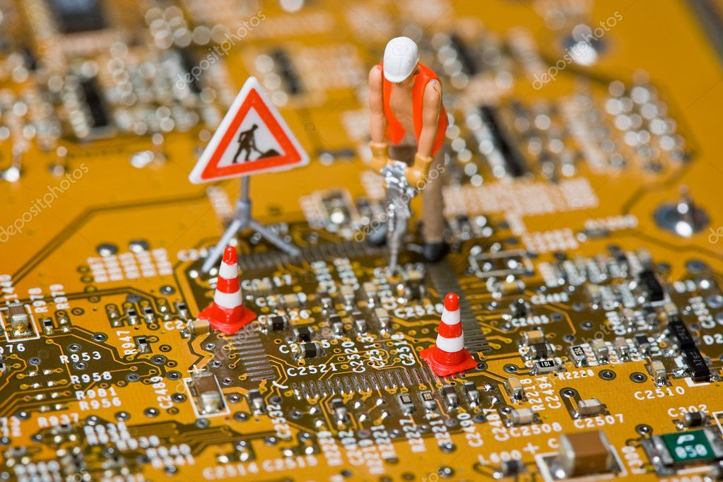 Macro shot of a miniature figures working on a circuit board. — Stock Photo #9074724
