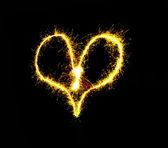Fiery heart on a black background — Stock Photo