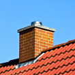 Stock Photo: Red roof with chimney