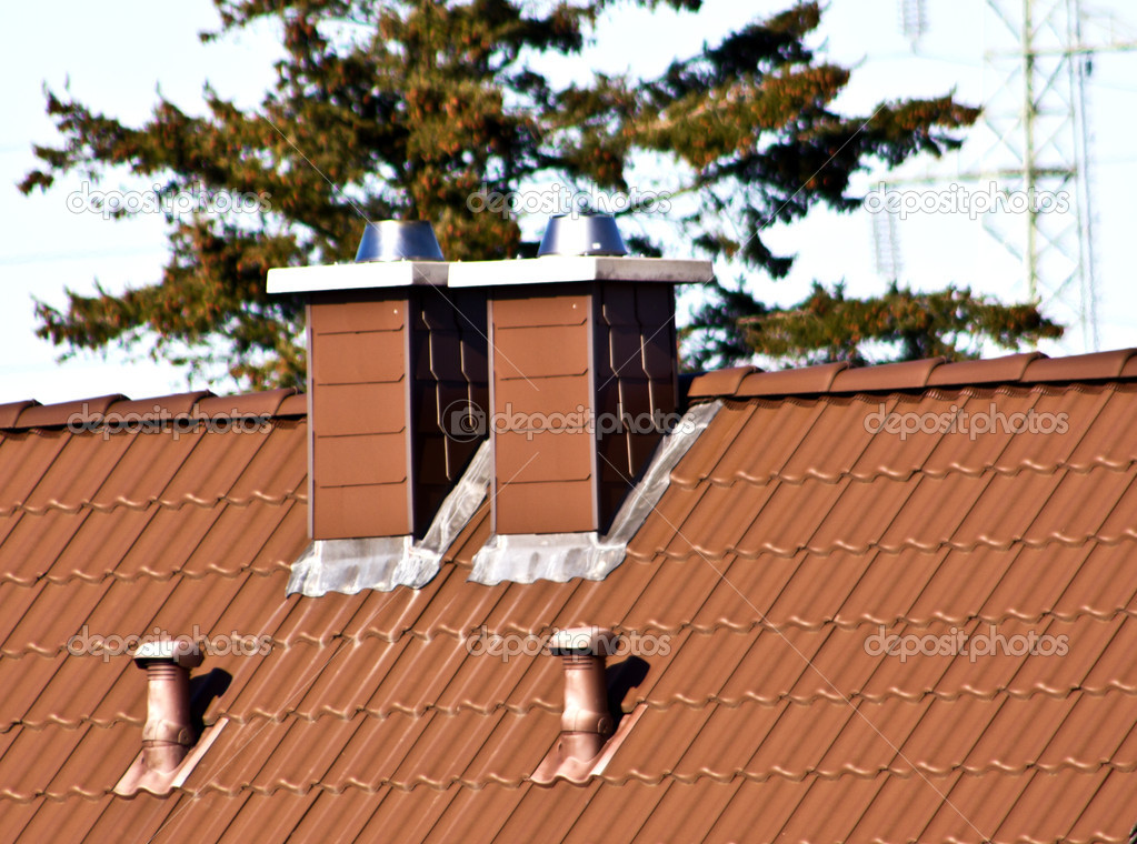 Closeup of red roof covering with brick-made chimney — Stock Photo #9226582