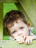 Sad little boy with bright blue eyes — Stock Photo