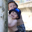 Two cheeky boys at the beach — Stock Photo