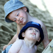 Stockfoto: Two cheeky boys at beach