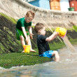 Two little boys playing at the beach — Stock Photo #9415449