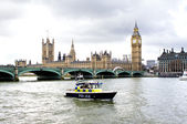 Police boat on the river thames outside parliment — Stock Photo