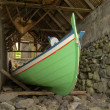 Traditional Faroese fishing boat made ​​of wood in an old bo — Stok fotoğraf