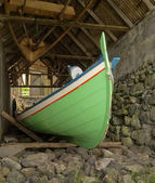 Traditional Faroese fishing boat made ​​of wood in an old bo — Stock Photo
