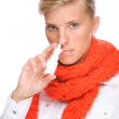 Stock Photo: Womwith nasal spray
