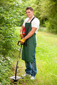 Gardener with lawn trimmer — Stock Photo