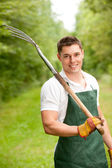Man with pitchfork — Stock Photo