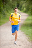 Young and happy jogger — Stock Photo