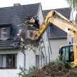 Digger demolishing house — Stock Photo