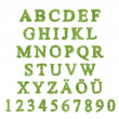 Alphabet with green grass letter — Stock Photo #9303997