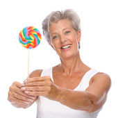 Senior woman with sweets — Stock Photo