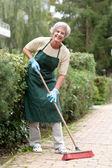 Senior with broom — Stock Photo