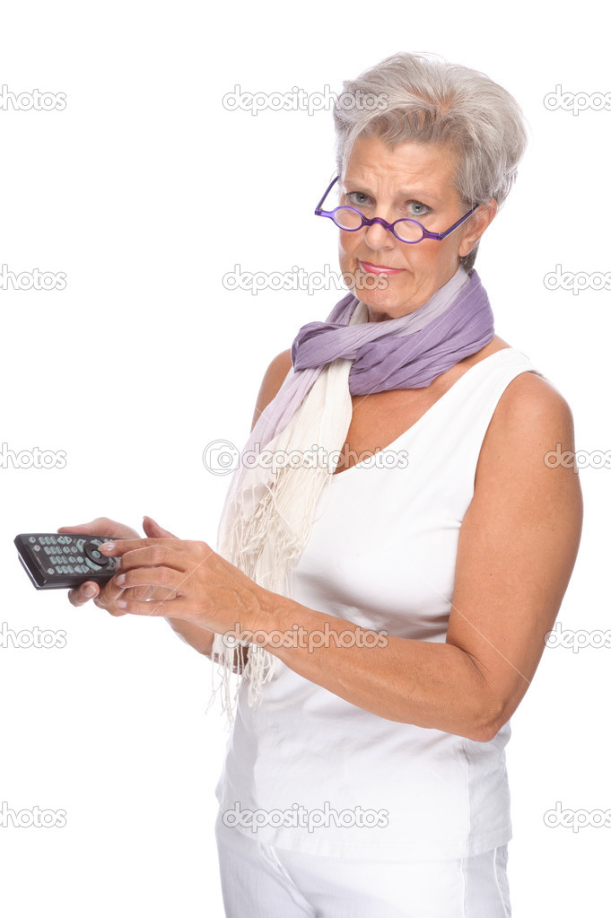 Full isolated portrait of a senior woman with remote control — Stock Photo #9302542